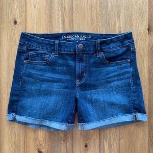 Size 10 AE raw edge, cuffed mid-rise denim shorts.